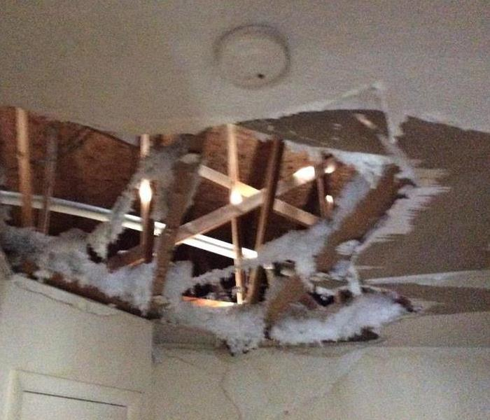 Collapsed ceiling after water damage Before